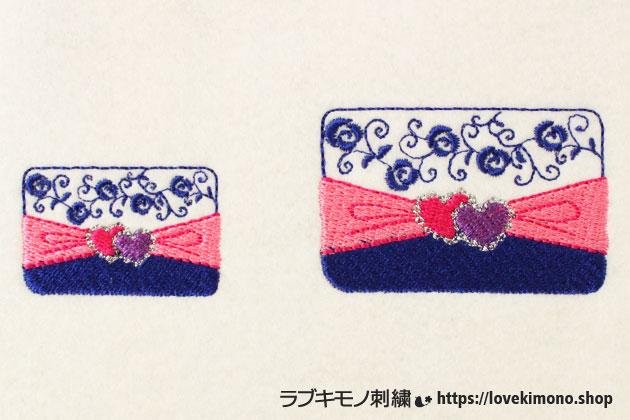 ハート、宝石、バラ模様のエレガントなクラッチバックの刺繍、大小サイズが並ぶ