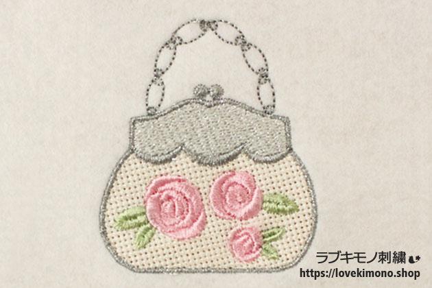 バラ柄とシルバーのラメ糸を使ったバーティーバックの刺繍